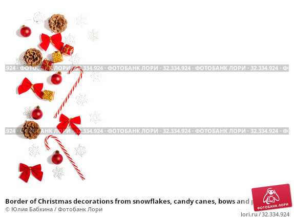 Купить «Border of Christmas decorations from snowflakes, candy canes, bows and pine cones on white background», фото № 32334924, снято 19 октября 2019 г. (c) Юлия Бабкина / Фотобанк Лори