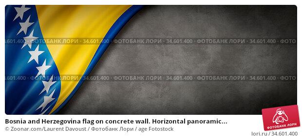 Bosnia and Herzegovina flag on concrete wall. Horizontal panoramic... Стоковое фото, фотограф Zoonar.com/Laurent Davoust / age Fotostock / Фотобанк Лори