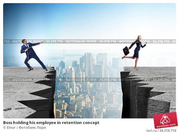 Boss holding his employee in retention concept. Стоковое фото, фотограф Elnur / Фотобанк Лори