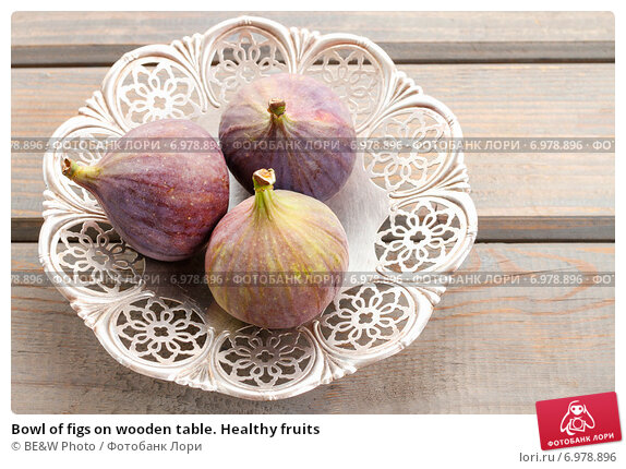 Купить «Bowl of figs on wooden table. Healthy fruits», фото № 6978896, снято 20 февраля 2019 г. (c) BE&W Photo / Фотобанк Лори