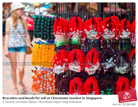 Купить «Bracelets and beads for sell at Chinatown market in Singapore», фото № 32543080, снято 16 декабря 2019 г. (c) easy Fotostock / Фотобанк Лори