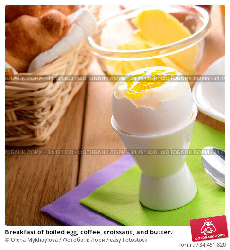 Breakfast of boiled egg, coffee, croissant, and butter. Стоковое фото, фотограф Olena Mykhaylova / easy Fotostock / Фотобанк Лори