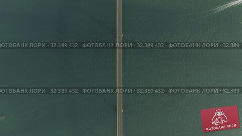 Купить «Bridge over the sea, asphalt road blue water Drone shot in Cambodia», видеоролик № 32389432, снято 26 октября 2019 г. (c) Aleksejs Bergmanis / Фотобанк Лори