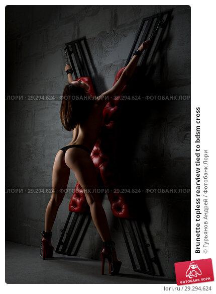 Купить «Brunette topless rearview tied to bdsm cross», фото № 29294624, снято 23 августа 2018 г. (c) Гурьянов Андрей / Фотобанк Лори