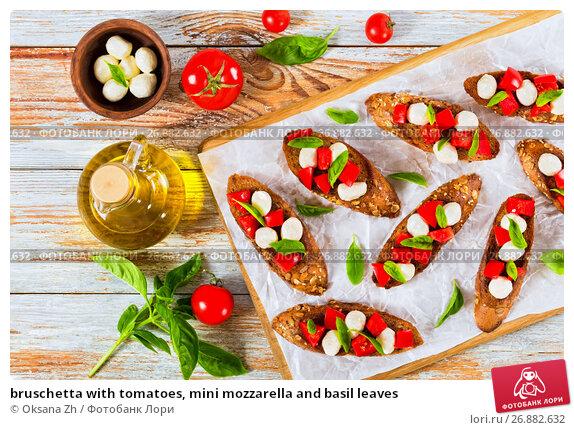 Купить «bruschetta with tomatoes, mini mozzarella and basil leaves», фото № 26882632, снято 29 августа 2016 г. (c) Oksana Zh / Фотобанк Лори