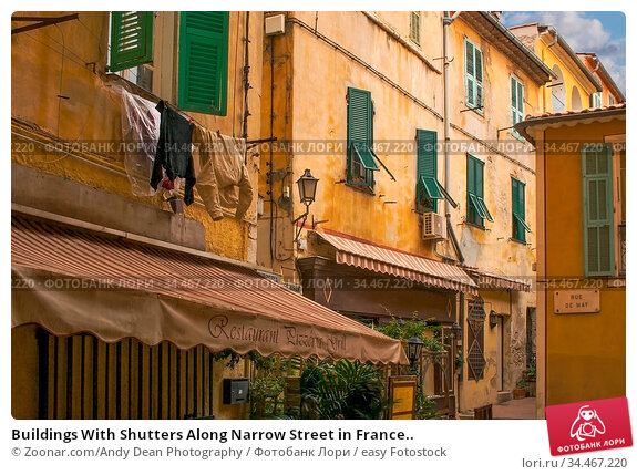 Buildings With Shutters Along Narrow Street in France.. Стоковое фото, фотограф Zoonar.com/Andy Dean Photography / easy Fotostock / Фотобанк Лори