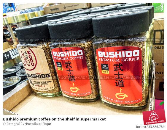 Купить «Bushido premium coffee on the shelf in supermarket», фото № 33836784, снято 29 декабря 2019 г. (c) FotograFF / Фотобанк Лори