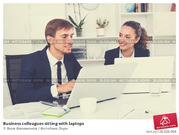 Купить «Business colleagues sitting with laptops», фото № 26026064, снято 20 марта 2018 г. (c) Яков Филимонов / Фотобанк Лори