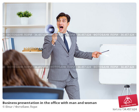 Business presentation in the office with man and woman. Стоковое фото, фотограф Elnur / Фотобанк Лори