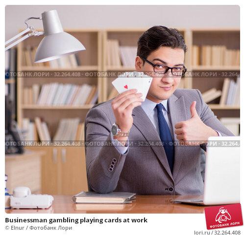 Купить «Businessman gambling playing cards at work», фото № 32264408, снято 18 января 2017 г. (c) Elnur / Фотобанк Лори