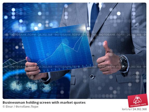 Купить «Businessman holding screen with market quotes», фото № 24302368, снято 13 июля 2020 г. (c) Elnur / Фотобанк Лори