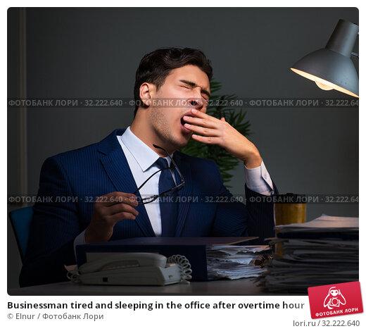 Купить «Businessman tired and sleeping in the office after overtime hour», фото № 32222640, снято 21 декабря 2017 г. (c) Elnur / Фотобанк Лори