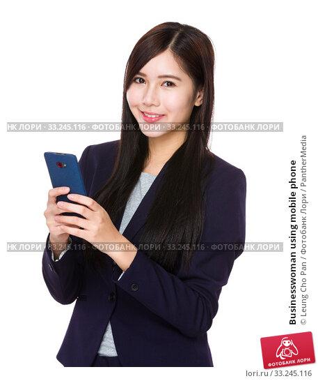 Купить «Businesswoman using mobile phone», фото № 33245116, снято 31 мая 2020 г. (c) PantherMedia / Фотобанк Лори