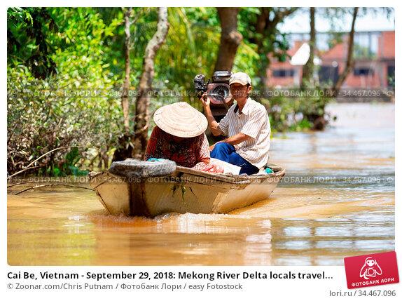 Cai Be, Vietnam - September 29, 2018: Mekong River Delta locals travel... Стоковое фото, фотограф Zoonar.com/Chris Putnam / easy Fotostock / Фотобанк Лори