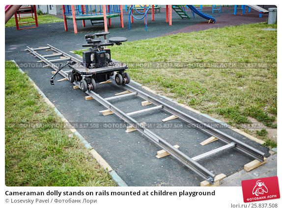 Cameraman dolly stands on rails mounted at children playground, фото № 25837508, снято 27 июня 2016 г. (c) Losevsky Pavel / Фотобанк Лори