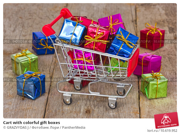 Cart with colorful gift boxes. Стоковое фото, фотограф GRAZVYDAS J / PantherMedia / Фотобанк Лори
