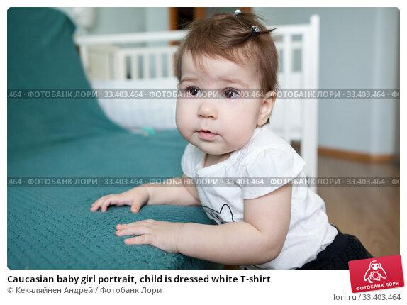 Купить «Caucasian baby girl portrait, child is dressed white T-shirt», фото № 33403464, снято 8 марта 2020 г. (c) Кекяляйнен Андрей / Фотобанк Лори