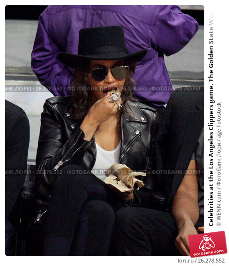 Купить «Celebrities at the Los Angeles Clippers game. The Golden State Warriors defeated the Los Angeles Clippers by the final score of 115-112 at Staples Center...», фото № 26278552, снято 20 февраля 2016 г. (c) age Fotostock / Фотобанк Лори
