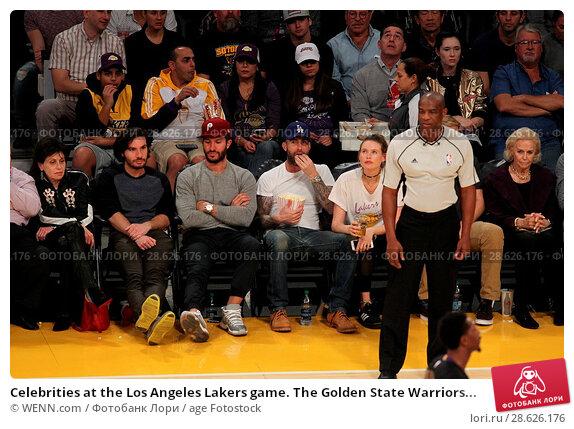 Купить «Celebrities at the Los Angeles Lakers game. The Golden State Warriors defeated the Los Angeles Lakers by the final score of 109-85 at the Staples Center...», фото № 28626176, снято 25 ноября 2016 г. (c) age Fotostock / Фотобанк Лори