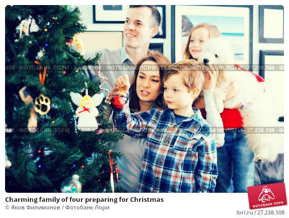 Купить «Charming family of four preparing for Christmas», фото № 27238108, снято 23 декабря 2016 г. (c) Яков Филимонов / Фотобанк Лори