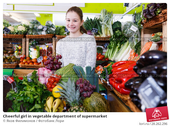 Купить «Cheerful girl in vegetable department of supermarket», фото № 28262296, снято 13 февраля 2018 г. (c) Яков Филимонов / Фотобанк Лори