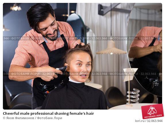 Cheerful male professional shaving female's hair. Стоковое фото, фотограф Яков Филимонов / Фотобанк Лори