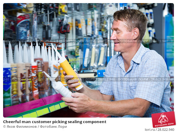 Купить «Cheerful man customer picking sealing component», фото № 28022940, снято 14 июля 2020 г. (c) Яков Филимонов / Фотобанк Лори