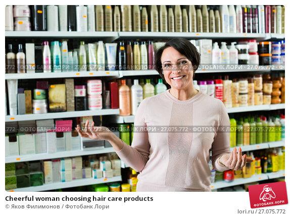 Купить «Cheerful woman choosing hair care products», фото № 27075772, снято 20 февраля 2019 г. (c) Яков Филимонов / Фотобанк Лори