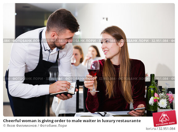 Cheerful woman is giving order to male waiter in luxury restaurante. Стоковое фото, фотограф Яков Филимонов / Фотобанк Лори