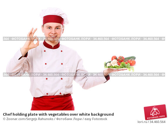 Chef holding plate with vegetables over white background. Стоковое фото, фотограф Zoonar.com/Sergejs Rahunoks / easy Fotostock / Фотобанк Лори