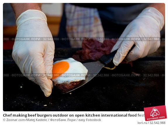 Купить «Chef making beef burgers outdoor on open kitchen international food festival event. Street food ready to serve on a food stall.», фото № 32542988, снято 9 декабря 2019 г. (c) easy Fotostock / Фотобанк Лори