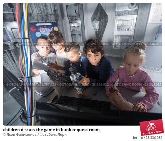 Купить «children discuss the game in bunker quest room», фото № 28336032, снято 21 октября 2017 г. (c) Яков Филимонов / Фотобанк Лори