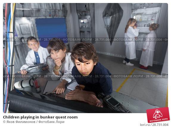 Купить «Children playing in bunker quest room», фото № 28731004, снято 21 октября 2017 г. (c) Яков Филимонов / Фотобанк Лори