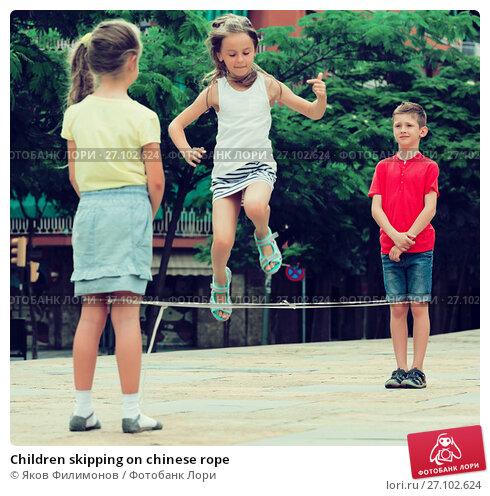 Купить «Children skipping on chinese rope», фото № 27102624, снято 18 ноября 2017 г. (c) Яков Филимонов / Фотобанк Лори