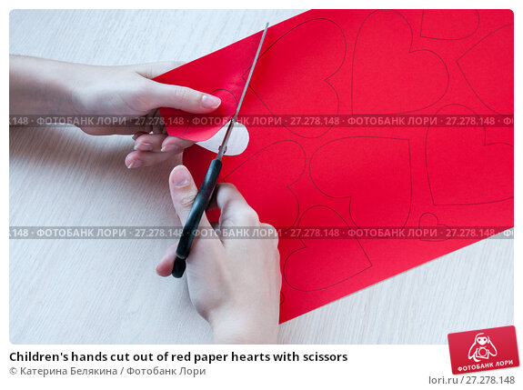 observing children cutting out with scissors