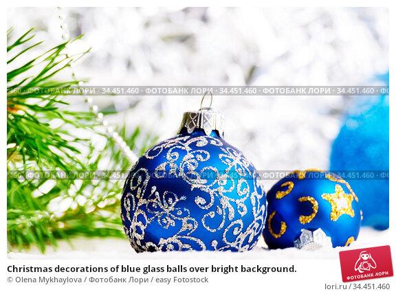 Christmas decorations of blue glass balls over bright background. Стоковое фото, фотограф Olena Mykhaylova / easy Fotostock / Фотобанк Лори