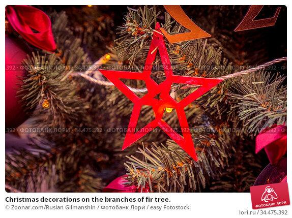 Christmas decorations on the branches of fir tree. Стоковое фото, фотограф Zoonar.com/Ruslan Gilmanshin / easy Fotostock / Фотобанк Лори