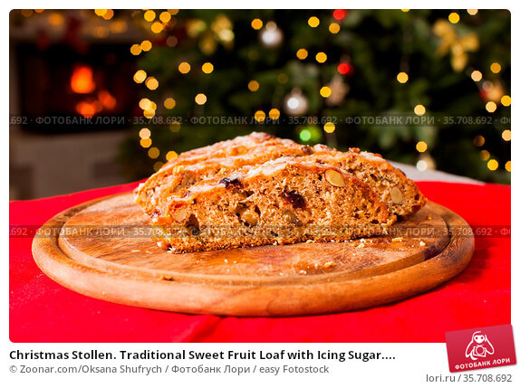 Christmas Stollen. Traditional Sweet Fruit Loaf with Icing Sugar.... Стоковое фото, фотограф Zoonar.com/Oksana Shufrych / easy Fotostock / Фотобанк Лори