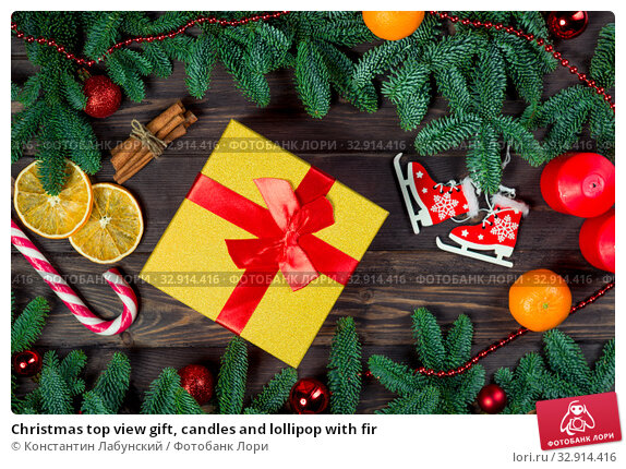 Christmas top view gift, candles and lollipop with fir. Стоковое фото, фотограф Константин Лабунский / Фотобанк Лори
