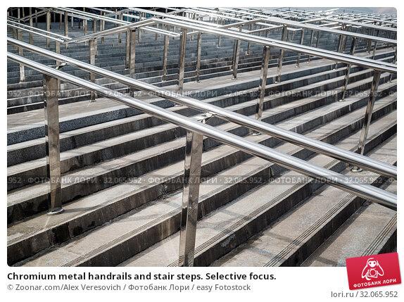 Chromium metal handrails and stair steps. Selective focus. Стоковое фото, фотограф Zoonar.com/Alex Veresovich / easy Fotostock / Фотобанк Лори