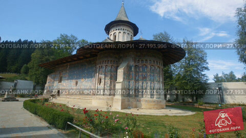 Купить «Church of Voronet Monastery is masterpiece of Bucovina painted churches», видеоролик № 27193996, снято 7 октября 2017 г. (c) Яков Филимонов / Фотобанк Лори