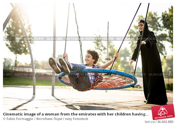 Cinematic image of a woman from the emirates with her children having... Стоковое фото, фотограф Fabio Formaggio / easy Fotostock / Фотобанк Лори