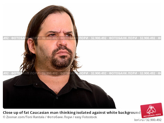 Close up of fat Caucasian man thinking isolated against white background. Стоковое фото, фотограф Zoonar.com/Toni Rantala / easy Fotostock / Фотобанк Лори