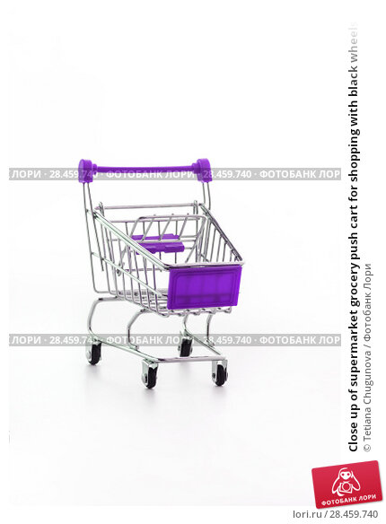 Купить «Close up of supermarket grocery push cart for shopping with black wheels and plastic elements on handle isolated on white background. Concept of shopping. Copy space for advertisement.», фото № 28459740, снято 16 июня 2017 г. (c) Tetiana Chugunova / Фотобанк Лори