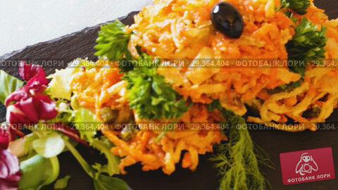 Купить «Close up of tasty fried vegetarian carrots cutlets with greens served at plate», видеоролик № 29364404, снято 15 октября 2018 г. (c) Яков Филимонов / Фотобанк Лори