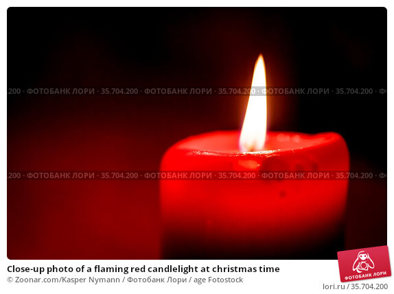 Close-up photo of a flaming red candlelight at christmas time. Стоковое фото, фотограф Zoonar.com/Kasper Nymann / age Fotostock / Фотобанк Лори