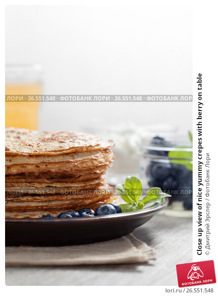 Купить «Close up view of nice yummy crepes with berry on table», фото № 26551548, снято 3 марта 2015 г. (c) Дмитрий Эрслер / Фотобанк Лори