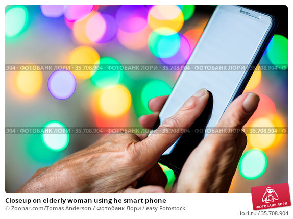 Closeup on elderly woman using he smart phone. Стоковое фото, фотограф Zoonar.com/Tomas Anderson / easy Fotostock / Фотобанк Лори