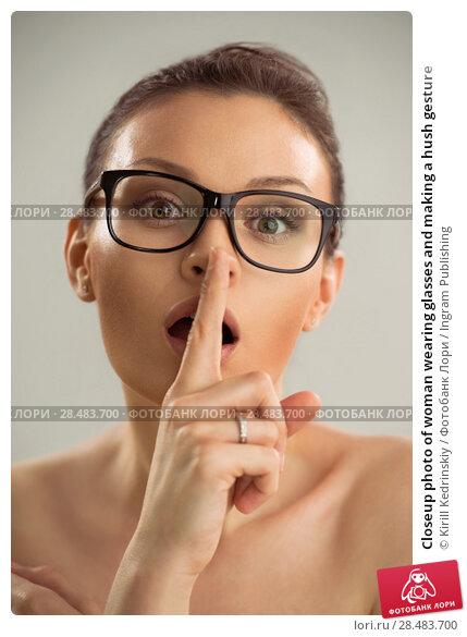 Купить «Closeup photo of woman wearing glasses and making a hush gesture», фото № 28483700, снято 22 сентября 2013 г. (c) Ingram Publishing / Фотобанк Лори