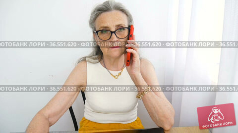Closeup portrait of angry upset senior mature businesswoman talking with someone at the office. Negative emotion, facial expression, scandal. Стоковое видео, видеограф Ольга Балынская / Фотобанк Лори
